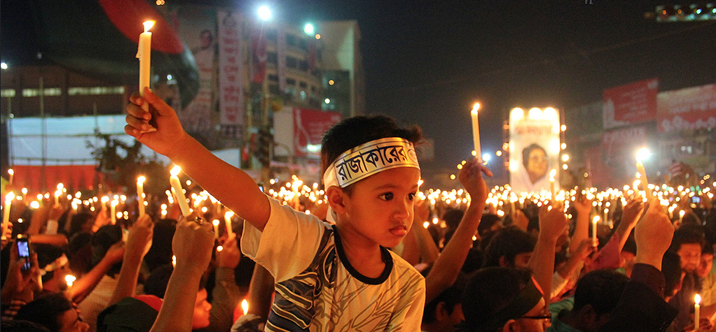 Protestors in India lighting a candle for peace.