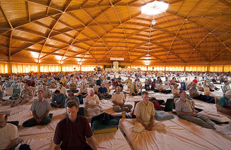 Hundreds of advanced TM-Sidhi practitioners meditation together in Fairfield, IA.