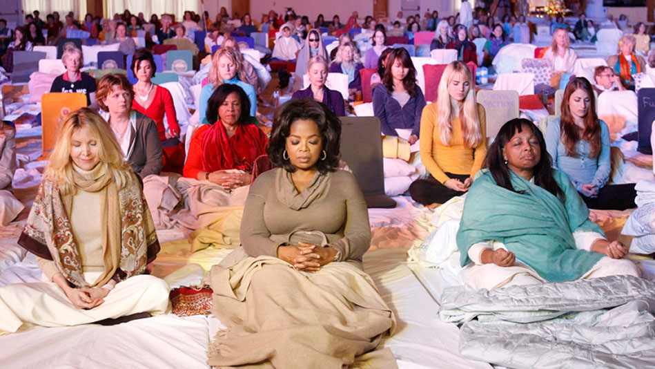 Oprah practicing Transcendental Meditation in a group.